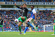 Blackburn Rovers Hope Akpan challenges during the Sky Bet Championship match between Blackburn Rovers and Bristol City at Ewood Park, Blackburn, England on 23 April 2016. Photo by Pete Burns.