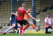 Peterborough United player Marcus Maddison scores a late consolation goal during the Sky Bet League 1 match between Southend United and Peterborough United at Roots Hall, Southend, England on 5 September 2015. Photo by Bennett Dean.