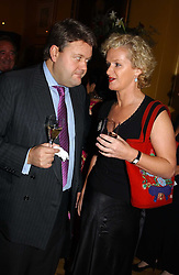 LORD STRATHCLYDE and KITTY ARDEN at a private view of jewellery designed and made by Luis Miguel Howard held at 30 Pavillion Road, London on 27th October 2004.<br /><br />NON EXCLUSIVE - WORLD RIGHTS