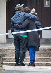 © Licensed to London News Pictures. 02/05/2019. London, UK. Two people console themselves as they view the crime scene at Somerford Grove in Hackney where a 15 year old boy was stabbed to death last night. Scotland Yard say police were called just before 9.00pm.The boy was pronounced dead at the scene at 9.49pm. Photo credit: Peter Macdiarmid/LNP