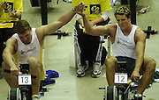&copy; Peter Spurrier/Sports Photo +44 (0) 7973 819 551.PPP Healthcare British Indoor Rowing Championships.18th Nov. 2001.National Indoor Arena..Matthew Pinsent (L) joins hand with his rowing partner James Craacknell, after he won [Pinsent] the British Indoor Rowing Championships at Birmingham in the final few sscc's of the race... ........... [Mandatory Credit: Peter SPURRIER/Intersport Images]<br /> <br /> 20011118 British Indoor Rowing Championships, Birmingham.
