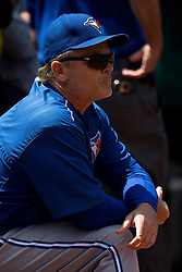 OAKLAND, CA - JULY 23:  John Gibbons #5 of the Toronto Blue Jays stands in the dugout during the sixth inning against the Oakland Athletics at O.co Coliseum on July 23, 2015 in Oakland, California. The Toronto Blue Jays defeated the Oakland Athletics 5-2. (Photo by Jason O. Watson/Getty Images) *** Local Caption *** John Gibbons