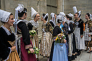 Runners-up congratulate Nolwenn Peuron, the 2016 Festival de Cornouaille Queen, third from left, on Sunday, July 24, 2016 in Quimper, France.