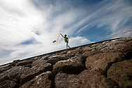 A young boy tries to fly a kite in Sanur on the Island of Bali in Indonesia.
