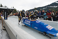 The German team of Thomas Florschutz, Enrico Kuehn, Marc Kuhne, and Andreas Barucha compete in the Mens' four-person bobsleigh World Cup competition held at the Whistler Sliding Centre on Feb 7, 2009