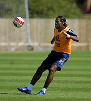 Photo: Daniel Hambury.<br />Chelsea Training Session. The Barclays Premiership. 24/07/2006.<br />Didier Drogba passes the ball during training.