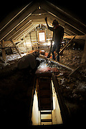 Greenhome, an energy audit company, audits  a Habitat for Humanity Critical Repair Home in Charlotte, NC.  Here, they inspect insulation and duct work in the attic.  Habitat for Humanity helps low income people upgrade their homes' energy efficiency.