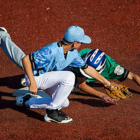 August 14, 2014: West Raleigh(NC)'s Matthew Willadsen (16) misses the throw to second base and Hanford(CA)'s Vince Rangel (12) slides in safely during the Cal Ripken 12u 70-foot World Series United States Semifinals at the Ripken Experience powered by Under Armour in Aberdeen, Maryland on August 14, 2014. Eric Patterson/Ripken Baseball/CSM