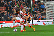 Stoke City striker Ramadan Sobhi holds off Hull City midfielder James Weir (17) in the final seconds of the game during the EFL Cup match between Stoke City and Hull City at the Britannia Stadium, Stoke-on-Trent, England on 21 September 2016. Photo by John Marfleet.
