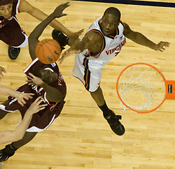 Virginia Cavaliers forward/guard Will Harris (1) reaches for a rebound against VT.  The Virginia Cavaliers Men's Basketball Team defeated the Virginia Tech Hokies 69-56 at the John Paul Jones Arena in Charlottesville, VA on March 1, 2007.