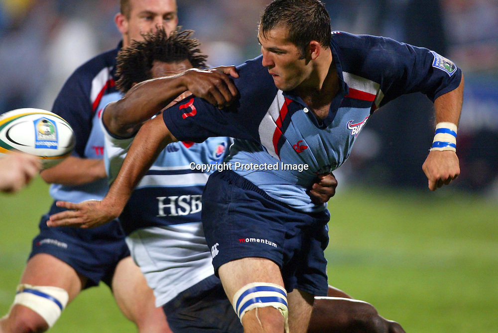 19 March, 2003. Loftus, Pretoria, South Africa. Rugby Union Super 12. Bulls vs Waratahs. <br /> Fourie du Preez on the attack with Lote Tuqiri defending.<br /> Bulls defeated the Waratahs 38-27.<br /> Pic: Photosport