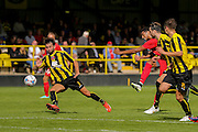 Vadaine Oliver shot watched by Andy McWilliams during the Friendly match between Harrogate Town and York City at Wetherby Road, Harrogate, United Kingdom on 25 July 2015. Photo by Simon Davies.