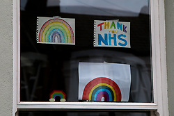 © Licensed to London News Pictures. 02/04/2020. London, UK. 'THANK YOU NHS' sign and hand painted rainbows on display in a window of a north London house. Rainbows are used as a symbol of peace and hope. Photo credit: Dinendra Haria/LNP