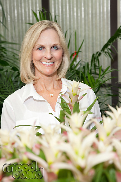Portrait of senior woman in greenhouse