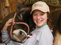Amber Paquette and Lenox from Mr. Vernon, take in a little down time at the Sandwich Fair on Saturday afternoon.  Amber and Lenox are entered in the 4H dairy showmanship events throughout the weekend.  (Karen Bobotas/for the Laconia Daily Sun)