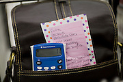 Sharon Ferrell's calculator and grocery list sit in her purse as she shops in Roseville, CA May 13, 2009.