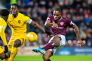 Uche Ikpeazu (#19) of Heart of Midlothian FC shoots for goal during the Ladbrokes Scottish Premiership match between Heart of Midlothian FC and Livingston FC at Tynecastle Park, Edinburgh, Scotland on 4 December 2019.