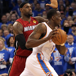Jun 12, 2012; Oklahoma City, OK, USA;  Miami Heat small forward LeBron James (6) defends Oklahoma City Thunder center Kendrick Perkins (5) during the first quarter of game one in the 2012 NBA Finals at the Chesapeake Energy Arena.  Mandatory Credit: Derick E. Hingle-US PRESSWIRE