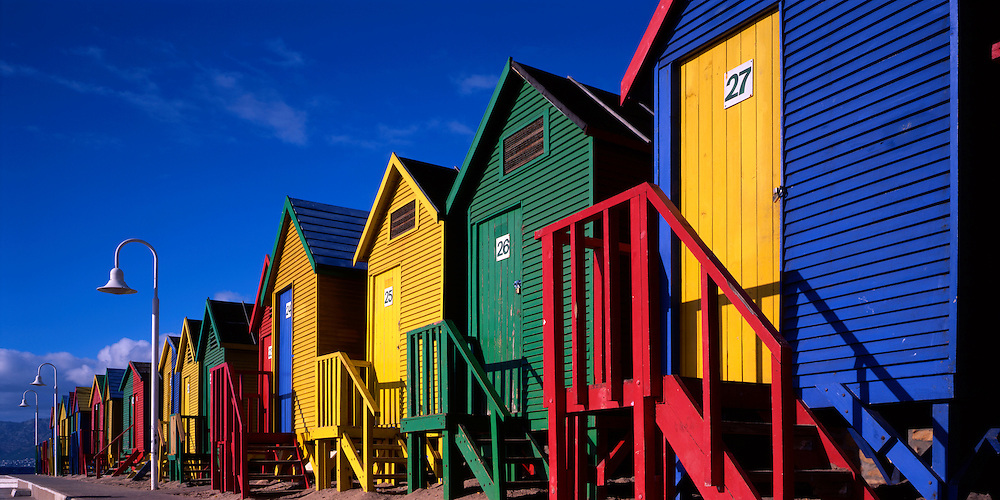 South Africa, Cape Town, Brightly painted bath houses along beach in Simon's Town along Cape Peninsula