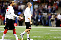 Colin Kaepernick (7) and Alex Smith (11) of the San Francisco 49ers warm up against the Baltimore Ravens during the NFL Super Bowl XLVII football game in New Orleans on Feb. 3, 2013. The Ravens won the game, 34-31.  (Photo by Jed Jacobsohn)