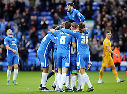 Martin Samuelsen of Peterborough United (hidden) is mobbed by team-mates after scoring the opening goal - Mandatory byline: Joe Dent/JMP - 09/01/2016 - FOOTBALL - ABAX Stadium - Peterborough, England - Peterborough United v Preston North End - FA Cup Third Round