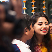 haldi ceremony or hould kota before bengali wedding. Beautiful bride and a brothers candid movement.