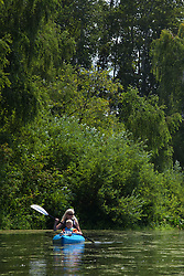North America, United States, Washington, Bellevue, woman and young boy kayaking in Mercer Slough Nature Park