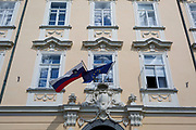 The Slovenian and the European Union flags hang together outside a building in the Slovenian capital, Ljubljana, on 27th June 2018, in Ljubljana, Slovenia.
