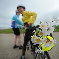 "Plastics daisies referred to as ""pedal power"" by Richard Lowe and Marilyn Graves, of Washington, don the rear of their two-seater bicycle during the Argus Leader's Tour de Kota."
