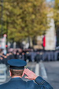 An RAF officer salutes during the National Anthem - Remembrance Sunday and Armistice Day commemorations fall on the same day, remembering the fallen of all conflicts but particularly the centenary of the end of World War One.