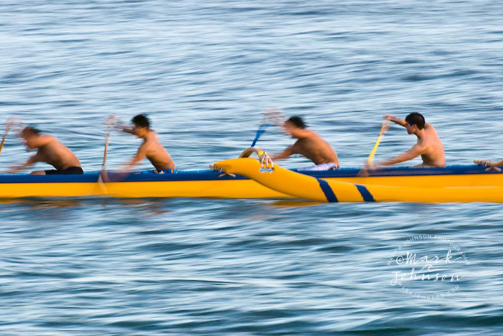 Outrigger canoe paddlers off Waikiki Beach, Oahu, Hawaii