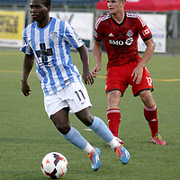 Wilmington Hammerheads FC's Sunny Jane challenges Toronto FC's Nick Hagglund Wednesday June 18, 2014 at Legion Stadium in Wilmington, N.C. (Jason A. Frizzelle)