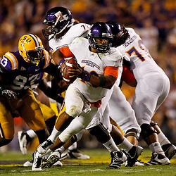 September 10, 2011; Baton Rouge, LA, USA;  Northwestern State Demons quarterback Brad Henderson (10) is pressured by LSU Tigers defensive tackle Bennie Logan (93) during the second half at Tiger Stadium. LSU defeat Northwestern State 49-3. Mandatory Credit: Derick E. Hingle