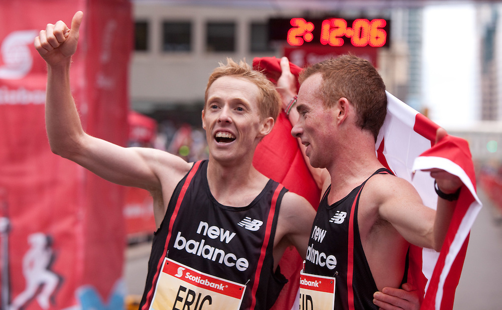 Toronto, Ontario ---11-10-16--- Eric Gillis, left, and Reid Coolsaet celebrate after their  4th and 3rd place finishes in the Scotiabank Toronto Waterfront Marathon, October 16, 2011.<br /> GEOFF ROBINS Mundo Sport Images