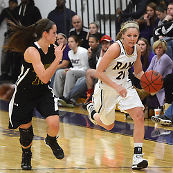 Staff photos by Tom Kelly IV<br /> West Chester's Brittany Sicinski (21) dribbles down court past Bloomsburg's Taylor Kaminski (10) during the Bloomsburg at West Chester University women's basketball game Saturday January 18, 2014.