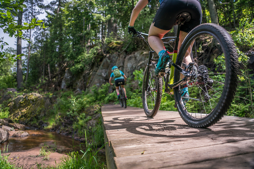 Mountain biking along the Dead River on the Noquemanon Trails Network North Trails in Marquette, Michigan.