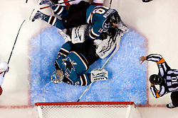 April 29, 2010; San Jose, CA, USA;  San Jose Sharks goalie Evgeni Nabokov (20) freezes the puck after center Joe Thornton (19) crashes into him during the third period against the Detroit Red Wings in game one of the western conference semifinals of the 2010 Stanley Cup Playoffs at HP Pavilion. San Jose defeated Detroit 4-3. Mandatory Credit: Jason O. Watson / US PRESSWIRE