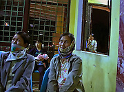Vietnam,Ninh Binh:watching TV at the train station.