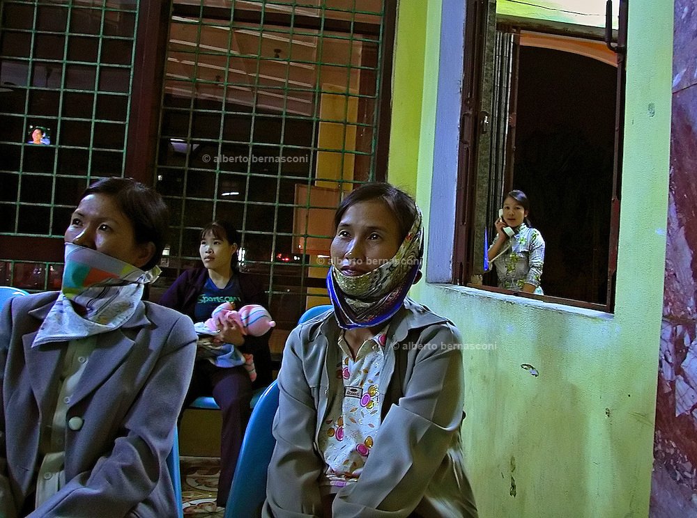 Vietnam,Ninh Binh:watching TV at the train station.