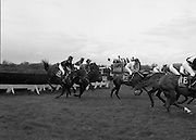 Irish Grand National At Fairyhouse.  (R54)..1987..20.04.1987..04.20.1987..20th April 1987..The Easter Racing Festival at Fairyhouse included the running of the Jameson sponsored Irish Grand National. Another featured race was the Jameson Gold Cup which was also run on Easter Monday...Image shows some of the runners clearing a hurdle in the running of the Jameson Irish Grand National at Fairyhouse, Co Meath.