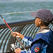 Fishing in the Hudson River from Battery Park, Lower Manhattan, New York, NY