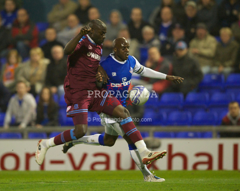 OLDHAM, ENGLAND - Monday, March 28, 2011: Tranmere Rovers' Enoch Showunmi and Oldham Athletic's Reuben Hazell during the Football League One match at Boundary Park. (Photo by David Rawcliffe/Propaganda)