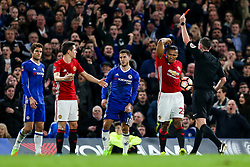 Luis Antonio Valencia reacts as Referee Michael Oliver shows a second yellow and then red card to  Ander Herrera of Manchester United - Rogan Thomson/JMP - 13/03/2017 - FOOTBALL - Stamford Bridge - London, England - Chelsea v Manchester United - FA Cup Quarter Final..