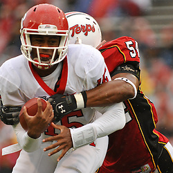 Sep 26, 2009; College Park, MD, USA; Rutgers quarterback Jabu Lovelace (15) is tackled by Maryland linebacker Adrian Moten (54) during the first half of Rutgers' 34-13 victory over Maryland in NCAA college football at Byrd Stadium.