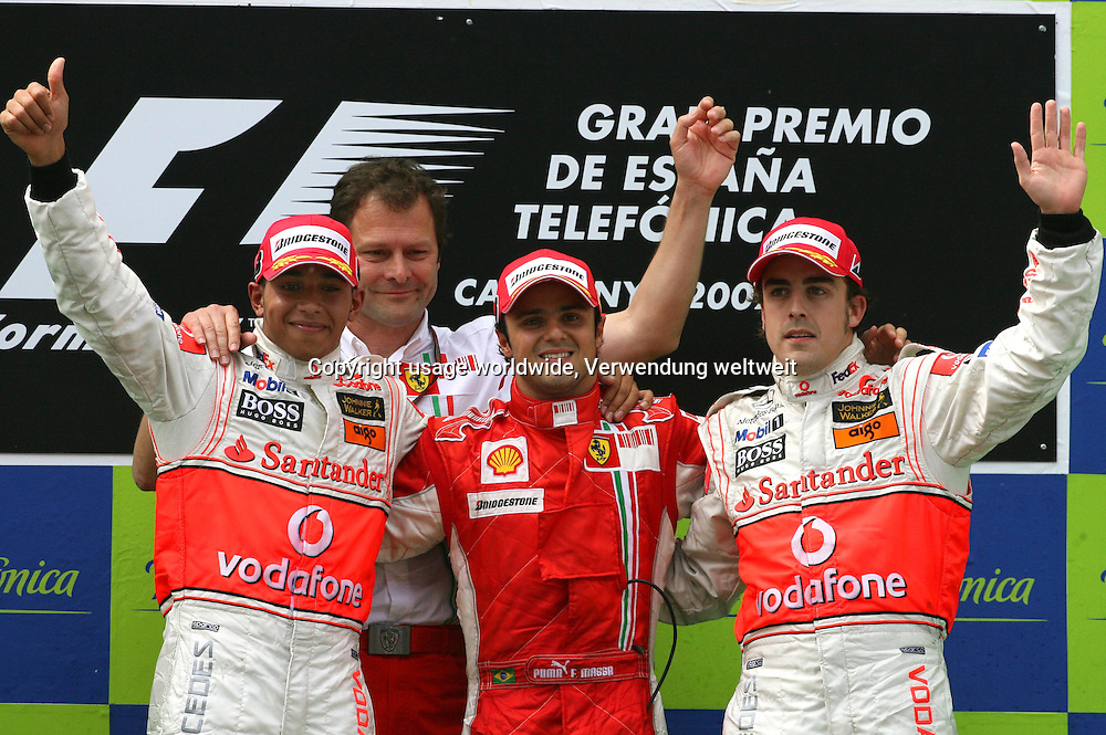 L-R British Formula 1 driver Lewis Hamilton of McLaren Mercedes, Aldo Costa the Chief Designer of Ferrari, Brazilian Formula One driver Felipe Massa of Ferrari and Spanish Formula One driver Fernando Alonso of McLaren Mercedes celebrate on the podium after the Spanish F1 Grand Prix held at the Montmelo circuit near Barcelona, Spain, 13 May 2007. Massa won ahead of Hamilton and Alonso. Photo: CARMEN JASPERSEN +++(c) dpa - Report+++
