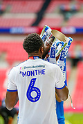 PROMOTED promotion Tranmere Rovers defender Emmanuel Monthe (6) kisses the trophy after the EFL Sky Bet League 2 Play Off Final match between Newport County and Tranmere Rovers at Wembley Stadium, London, England on 25 May 2019.