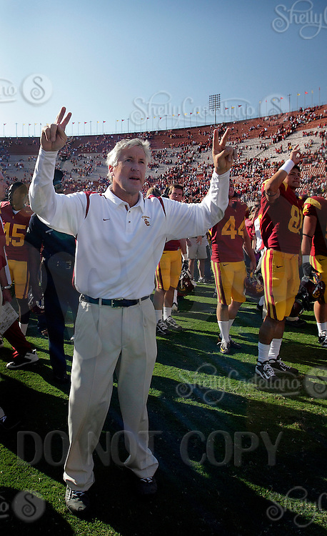 11 October 2008: NCAA Pac-10 USC Trojans 28-0 shut-out win over the Arizona State University Sun Devils during a day college football game at the Los Angeles Memorial Coliseum in Southern California. Head Coach Pete Carroll sporting the fight on hand sign after a win.