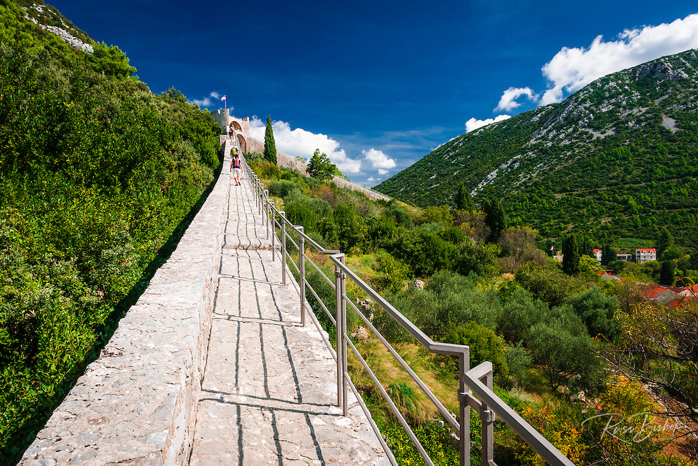 Tourists on the Great Wall above the city center, Ston, Dalmatian Coast, Croatia