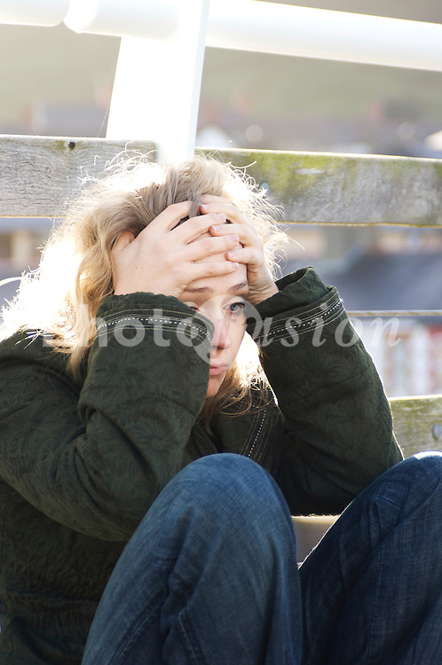 Young woman looking depressed UK