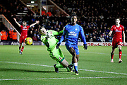 Walsall goalkeeper Liam Roberts and Peterborough United forward Ivan Toney (17) battle for the ball during the EFL Sky Bet League 1 match between Peterborough United and Walsall at London Road, Peterborough, England on 22 December 2018.